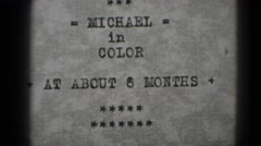1947: michael in color at about 6 months baby boy high chair MIDDLETOWN Stock Footage