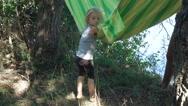 Smearing girl in hammock Stock Footage