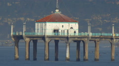 The Manhattan Beach Pier stands majestic over the Pacific Ocean. Stock Footage