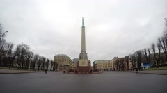 People visit Riga Freedom Monument at daytime time lapse Stock Footage