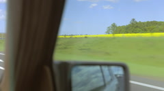 Driving a vintage car on a highway. Yellow fields outside. Stock Footage
