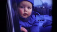 1947: baby head out of the car window ,observing things around. MIDDLETOWN Stock Footage
