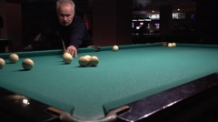 Middle-aged man with a beard playing billiards Stock Footage