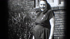1947: pregnant women laughing in the lawn MIDDLETOWN Stock Footage