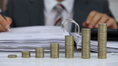 Businessman Calculating Invoice With Coins Stack Stock Footage