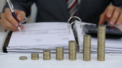 Businessman Calculating Expenses With Coins Stack Stock Footage