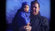 1947: fat father holding chubby child and tries to make him smile MIDDLETOWN Stock Footage