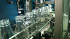 Liquid Product Manufacturing. Empty Clean Transparent Bottles Moving in One Stock Footage