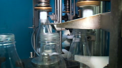 Dairy Manufacturing. Bottling Part of the Line. Clean Empty Bottles Arriving to Stock Footage