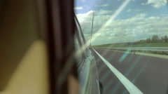 Side-view mirror in a vintage car. Driving along the expressway. Stock Footage