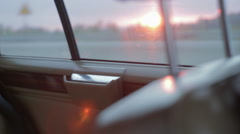 Driving a vintage car in the sunset. View through the window. Stock Footage