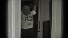 1947: baby walking wall assisted MIDDLETOWN Stock Footage