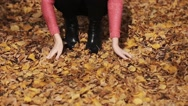 Nature outdoor playing relax leisure concept. Crazy girl throwing leaves Stock Footage
