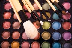 Colorful eye shadows palette with professional make-up brush Stock Photos