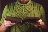 Bearded man reading Stock Photos