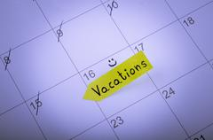 Vacation day is marked on a calendar Stock Photos