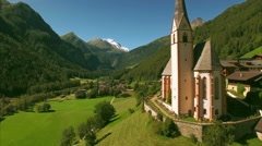 Church of St Vincent in Heiligenblut, aerial footage Stock Footage