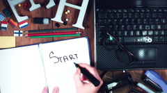 """4k Technology Composition from Above of Hand Writing """"Start Up"""" Stock Footage"""