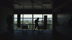 Silhouette of a boxer in the hall Stock Footage