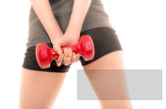 Close up, muscular woman body with dumbells copyspace sign Stock Photos