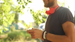 Urban smart casual handsome young man talking on smartphone Stock Footage