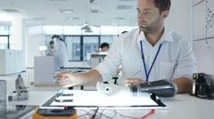4K Electronics engineering team building & testing robotics & electronics Stock Footage