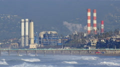 A power generating station and the ocean. Stock Footage