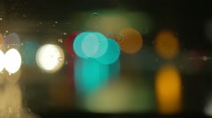 Driving a car at night. Raindrops on the windshield. Green, red, white lights. Stock Footage