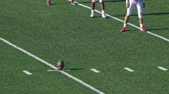 A football kicker prepares to kick the ball. Stock Footage