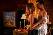 Loving couple kissing in romantic interior. Stock Photos