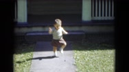 1947: child taking early steps in front of home while holding stick MIDDLETOWN Stock Footage