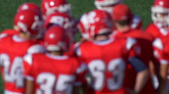 A football team huddles. Stock Footage