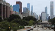 4K UltraHD Timelapse Chicago Skyline with transit in foreground Stock Footage