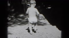 1947: baby boy exploring outdoor area in white diapers MIDDLETOWN Stock Footage