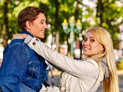 Young couple in love hugging and flirting in autumn park. Stock Photos