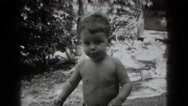 1947: little boy playing outdoor with family MIDDLETOWN Stock Footage