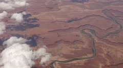 Aerial shot looking down on a winding river in the southwestern U.S. desert Stock Footage