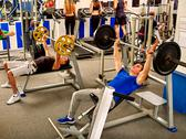 Group of people working his body at gym. Stock Photos
