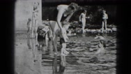 1947: woman dipping little boy in pond MIDDLETOWN Stock Footage
