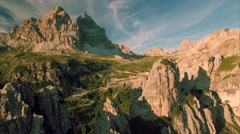 Evening aerial view of Tre Cime in the Alps Stock Footage