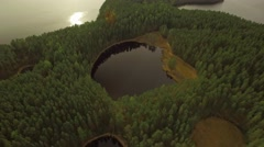 Pond inside a natural island at a calm Nordic lake, aerial tilt shot Stock Footage