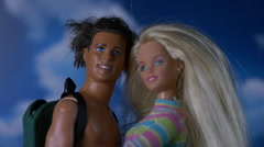 DOLL COUPLE LOOKING IN VOGUE Stock Footage