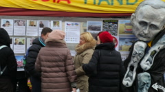 People near explain wall for sign petition for more sanctions against Russia Stock Footage