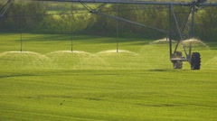 Automated farm Irrigation system with drop sprinklers in field Stock Footage