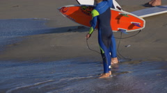 Some youth surfer boys get ready to go surfing. Stock Footage