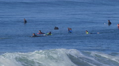 A crowded lineup of surfers surfing. Stock Footage