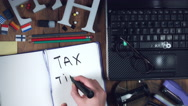 4k Technology Composition from Above of Hand writing 'Tax Time' Stock Footage