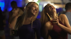 Happy female friends enjoying party on dance floor, clanging cocktail glasses Stock Footage