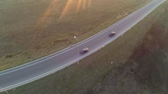 Aerial shot of highway junction, drone follow the car Stock Footage