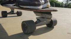 Close up of skateboarder guy on his skate in the park in summer sunny day. Stock Footage